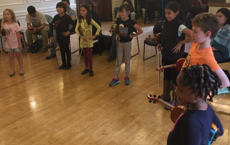 Saucy poses in violin group class