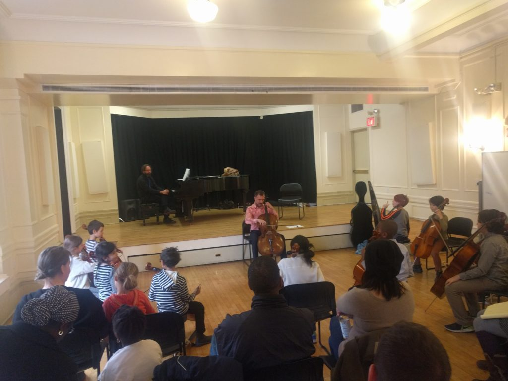 Alex Croxton teaching a group of cellists